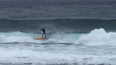 Surfer at Banzai Pipeline.
